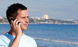 Man talking on phone while on a beach